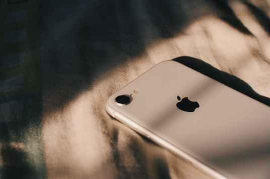 iphone on white textile