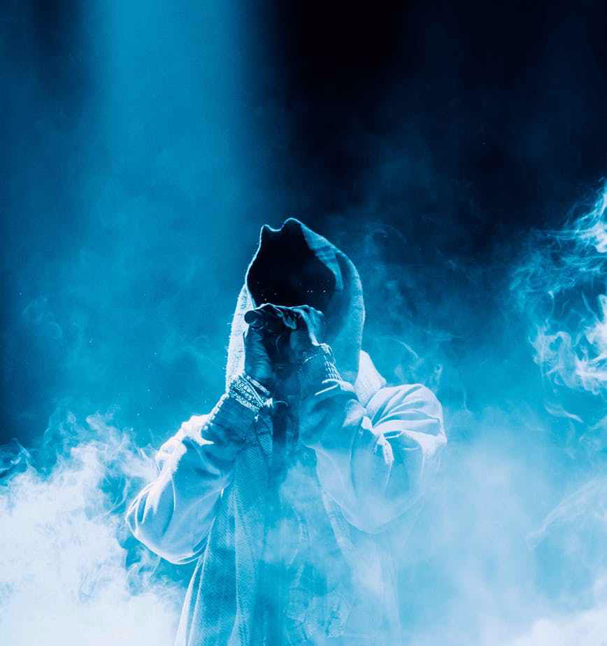 photo of person standing around smokes