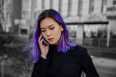 woman in black outfit with purple hair